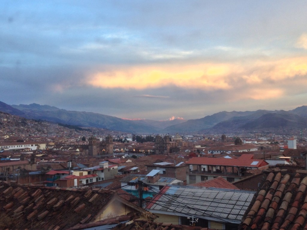 Cusco at sunset. The two cathedrals near the center of the picture border the main plaza