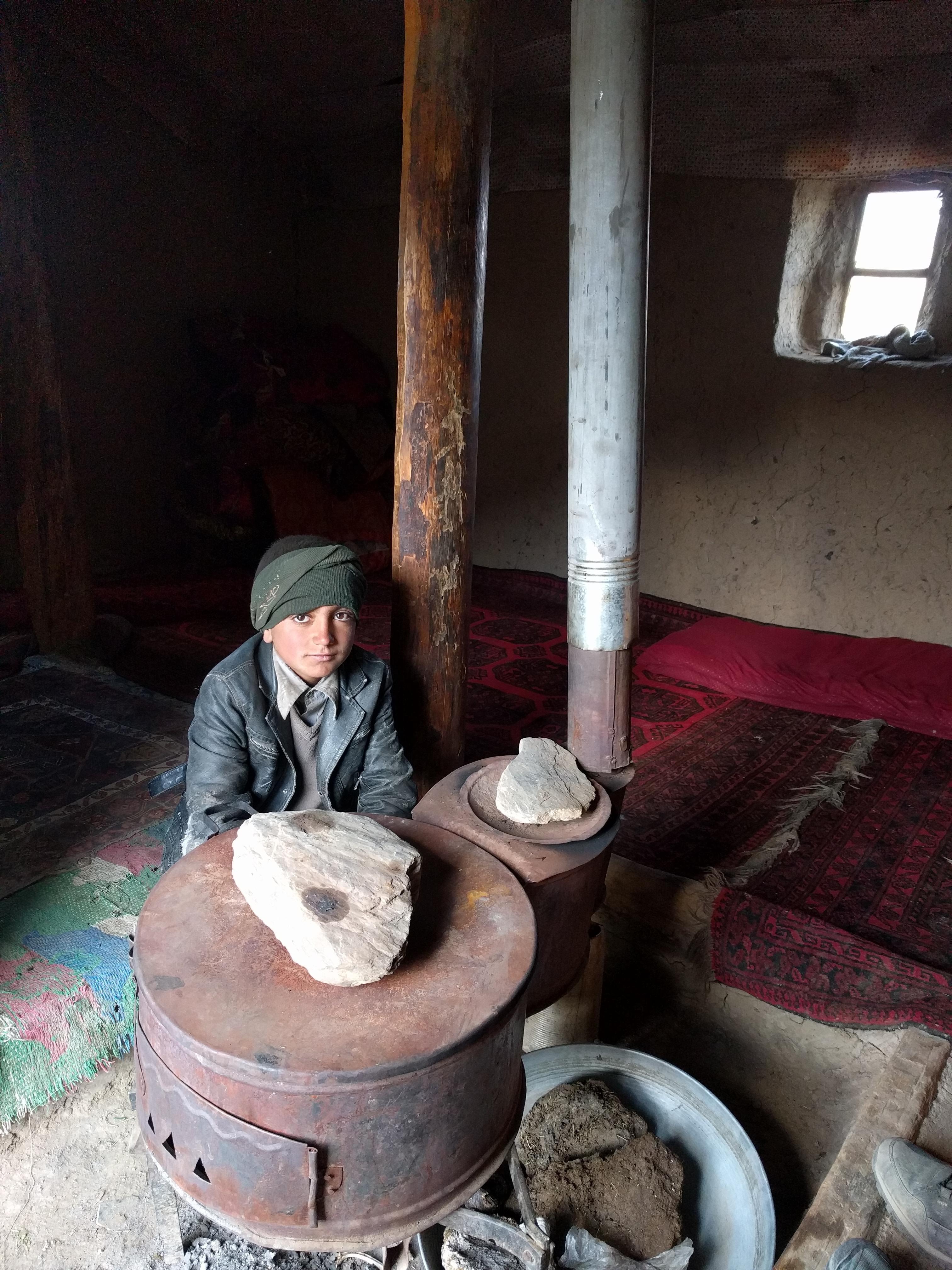Wakhi boy near stove